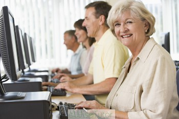 4-people-sitting-at-computer-terminals-2-seniors-2-adults1
